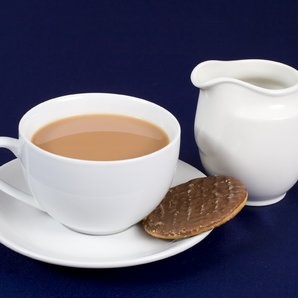 Tea milk and digestive stock image