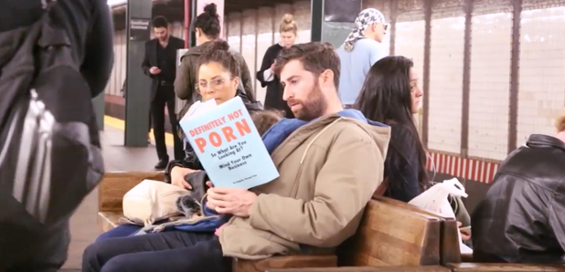 Men Read Fake book covers on New York Subway