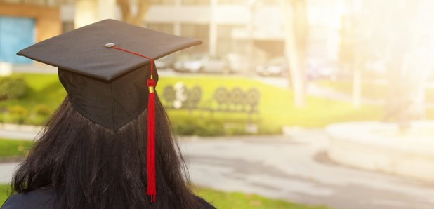 Woman student in cap and gown stock image
