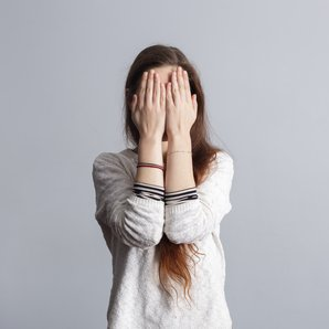 Embarrassed woman stock image